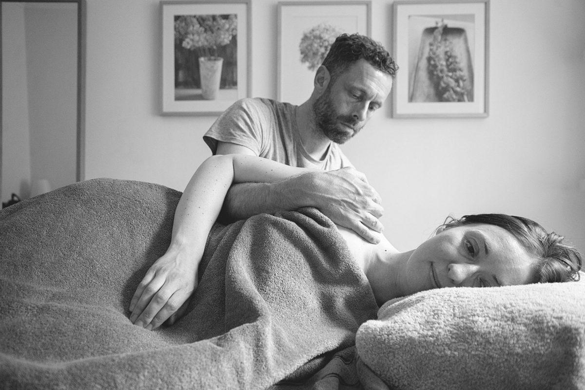 practioner stu lee massages woman's shoulder blades