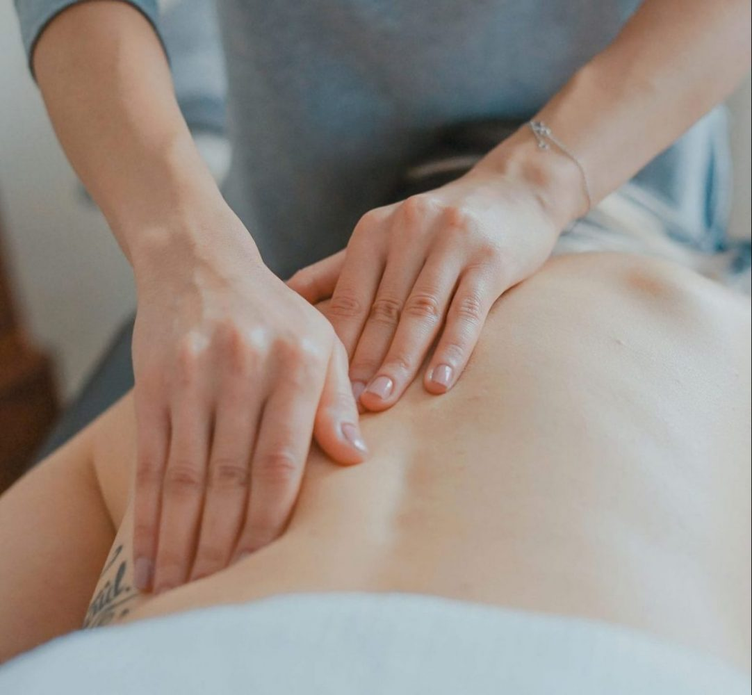 person being given a back massage