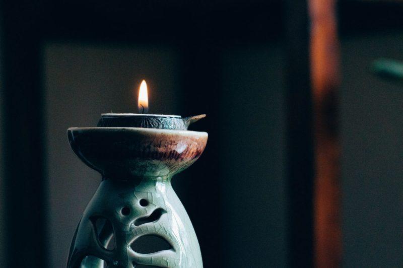 candle in ceramic holder